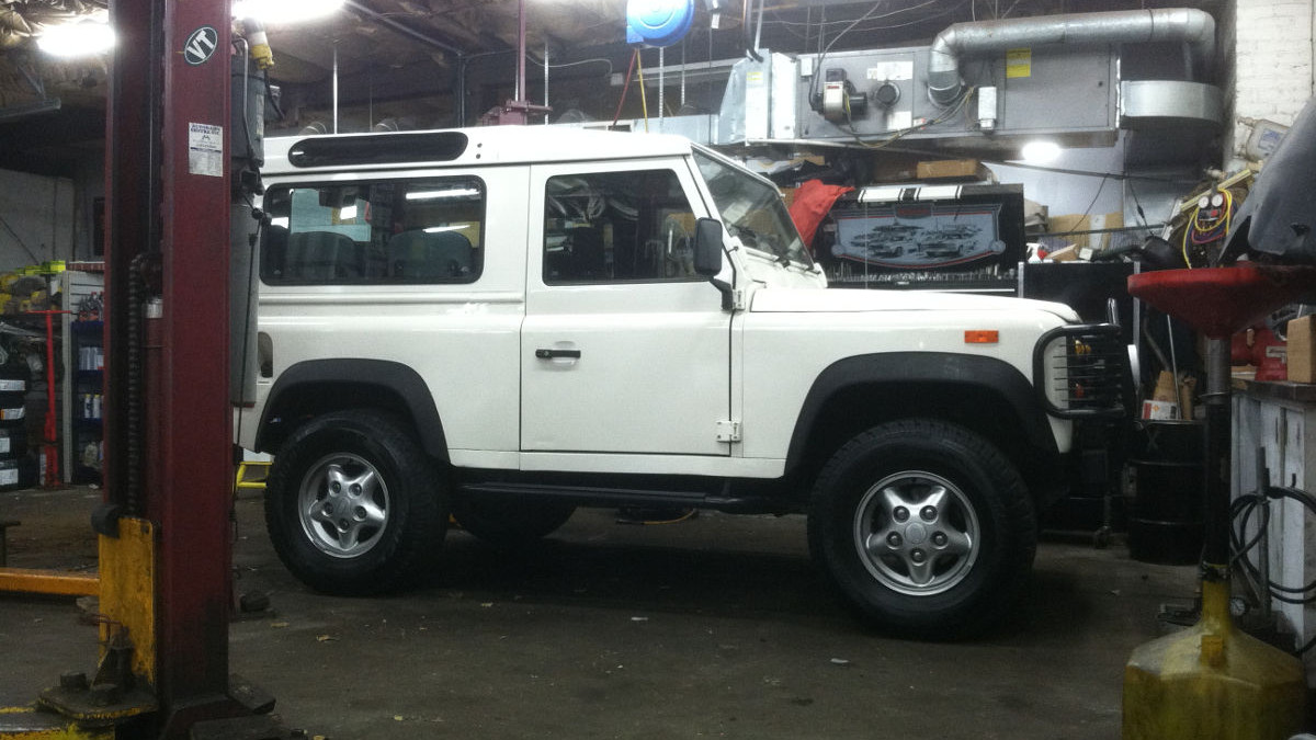 image of a white Land Rover under repair in Autobahn Centre's Shop